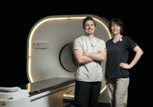 PET Technologists Austin Jones and Tammy Taylor with new digital PET scanner