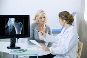 Technologist discussing Bone Density exam with patient